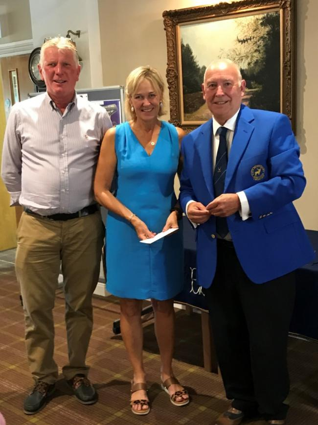 Amanda Cooper and Terry Hale from Marlborough GC receive their prize from the East Berks captain Peter Stevens