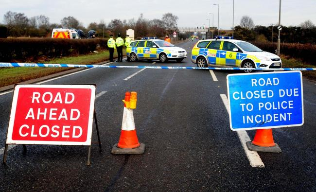 Police on the A614 in Nottinghamshire where six people were killed in a two-car crash.