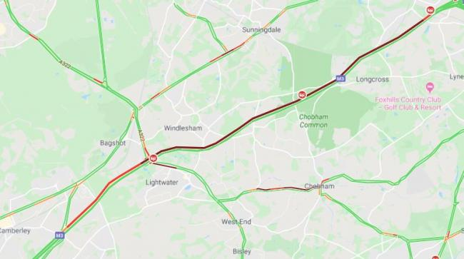 Eight mile queues after car and motorbike crash on M3
