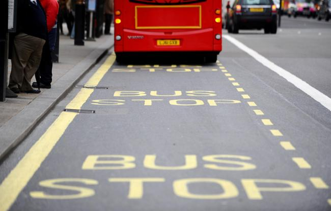 A stock picture of a bus at a bus stop on Parliament Street in London.