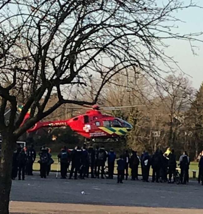 Air Ambulances land in a school in Winnersh to treat a man nearby.