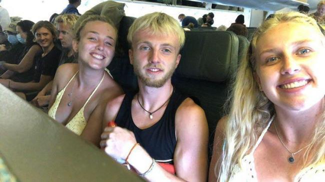 Kathryn Hayes (left) and Louis Hayes (centre) were stuck in Bali with friend Marli Holland (right)
