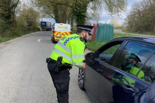 Police hand out fines in Bicester. Pic from Thames Valley Police