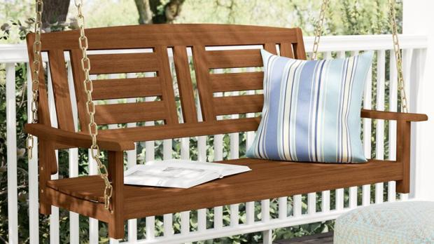 Bracknell News: How quaint is this wooden porch swing? Credit: Wayfair