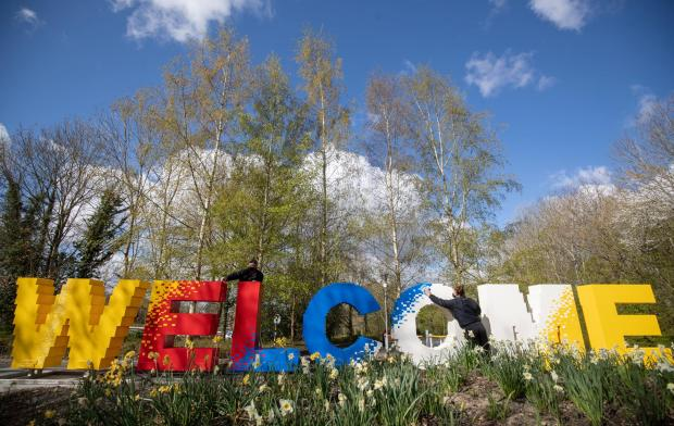 Bracknell News: Legoland Model Makers, Nicola Parker (right) and Elliott Ayton-Smith clean and add bricks to a Lego welcome sign as finishing touches are made at the Legoland Windsor Resort