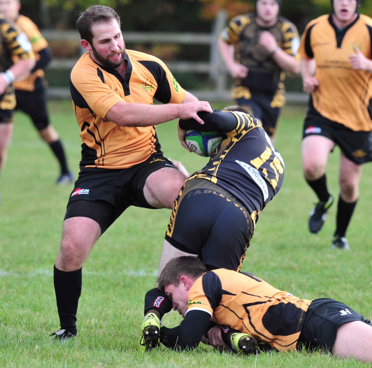 Crowthorne's Sam Short makes a tackle against Tadley    Picture by Dave Schofield