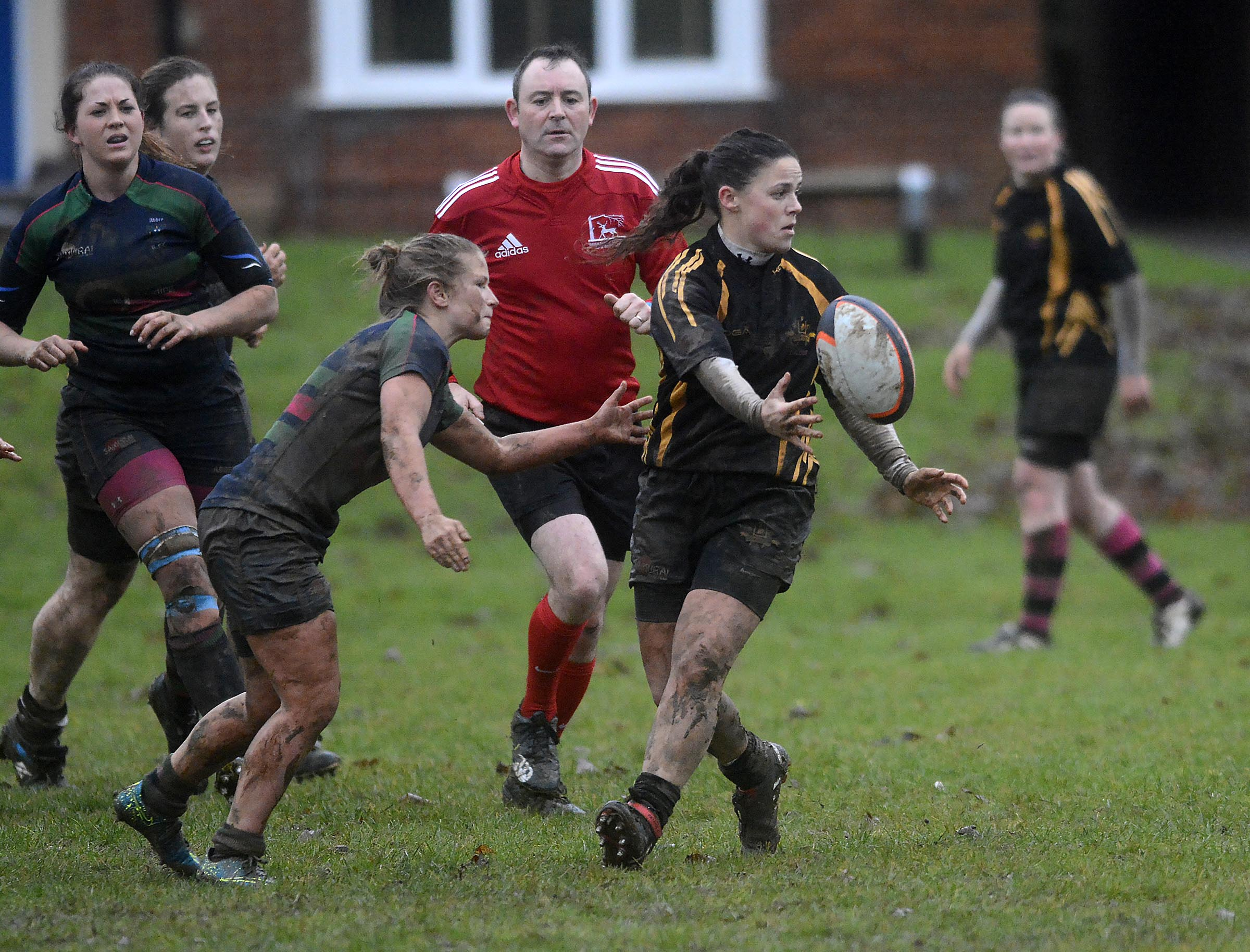Yasmine Jenkins off-loads during Crowthorne Thorns 31-7 defeat to Reading Abbey Nuns