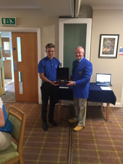East Berks club champion Harrison Arnold collects the trophy from captain George Ennis