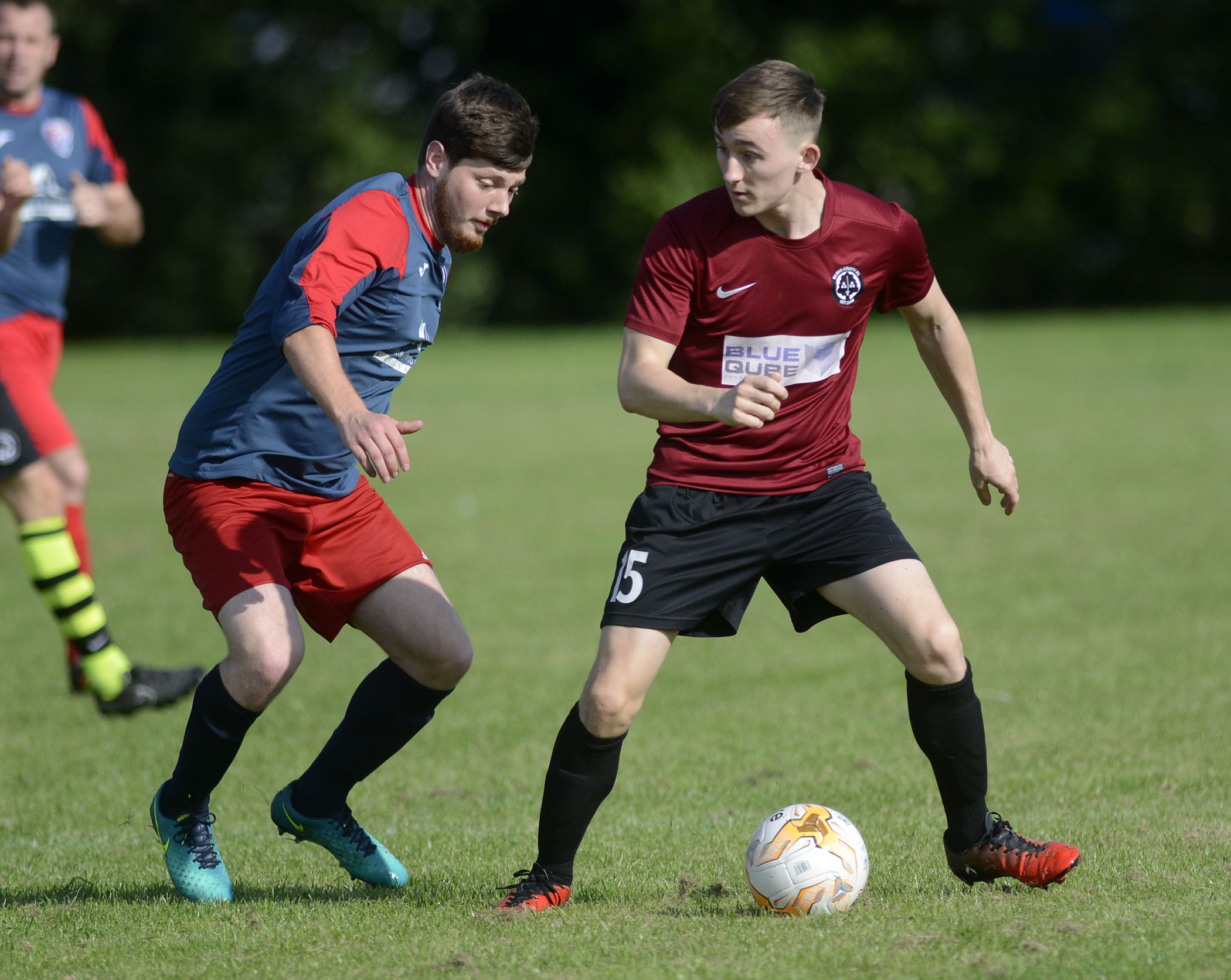 Action from Bracknell Athletic's (blue) 3-3 draw with Berks County