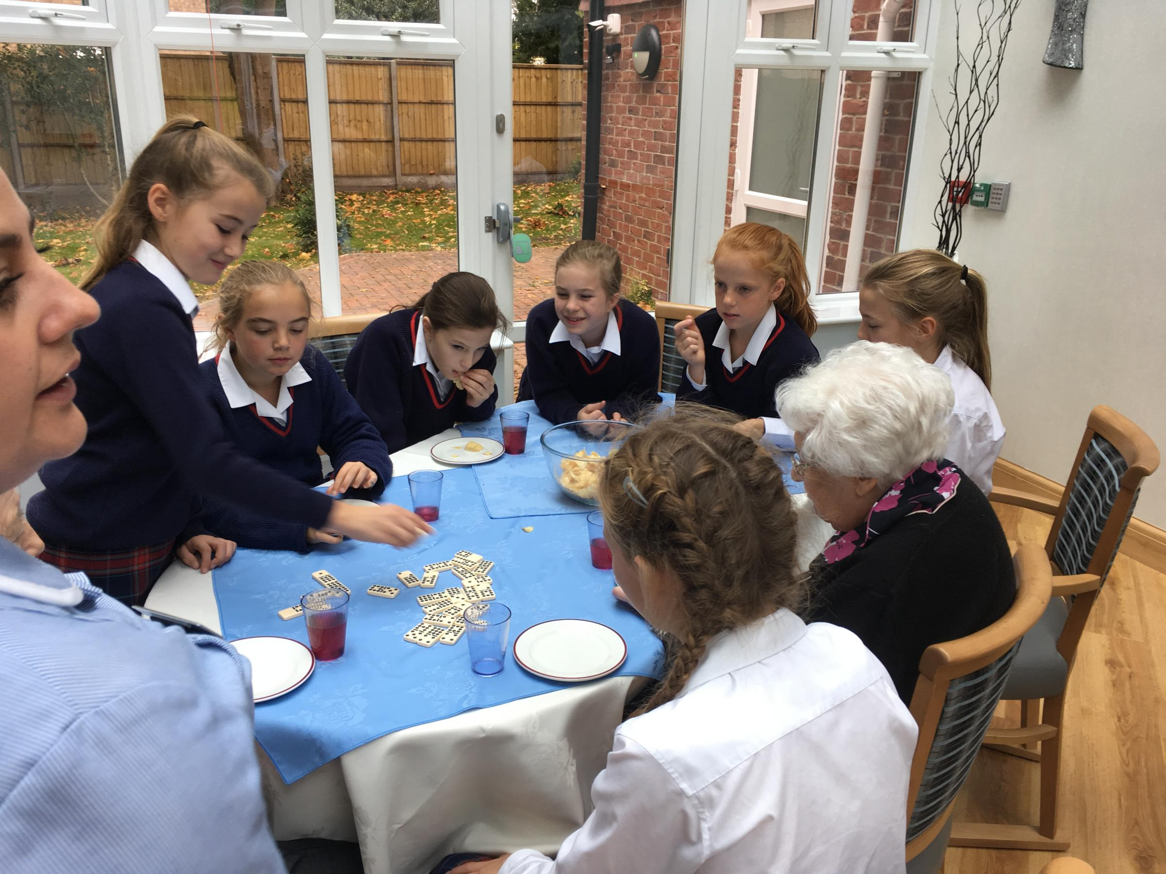 School students take time out of weekends to visit care home|