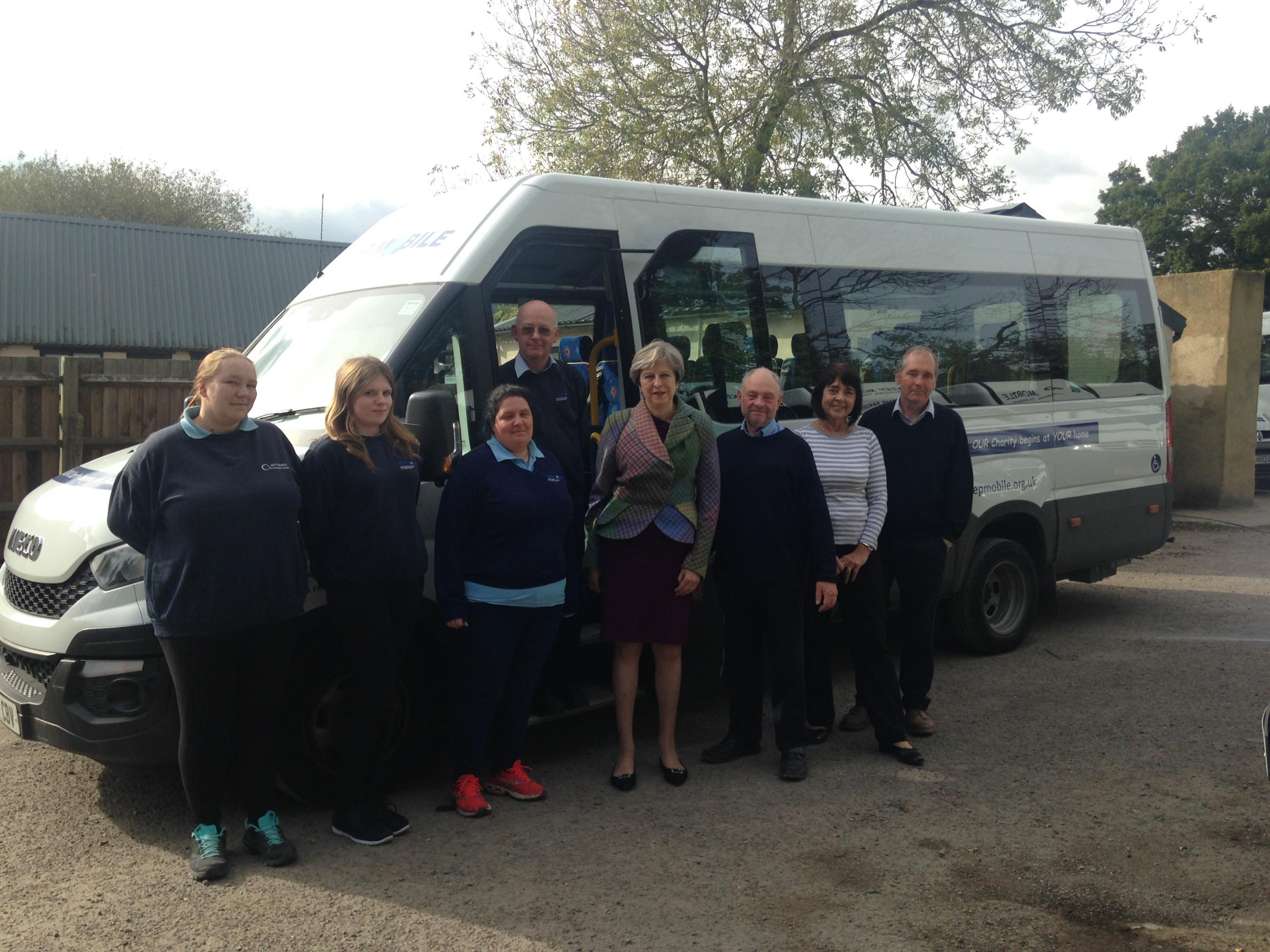 Prime Minister visits local charity and takes minibus ride around town
