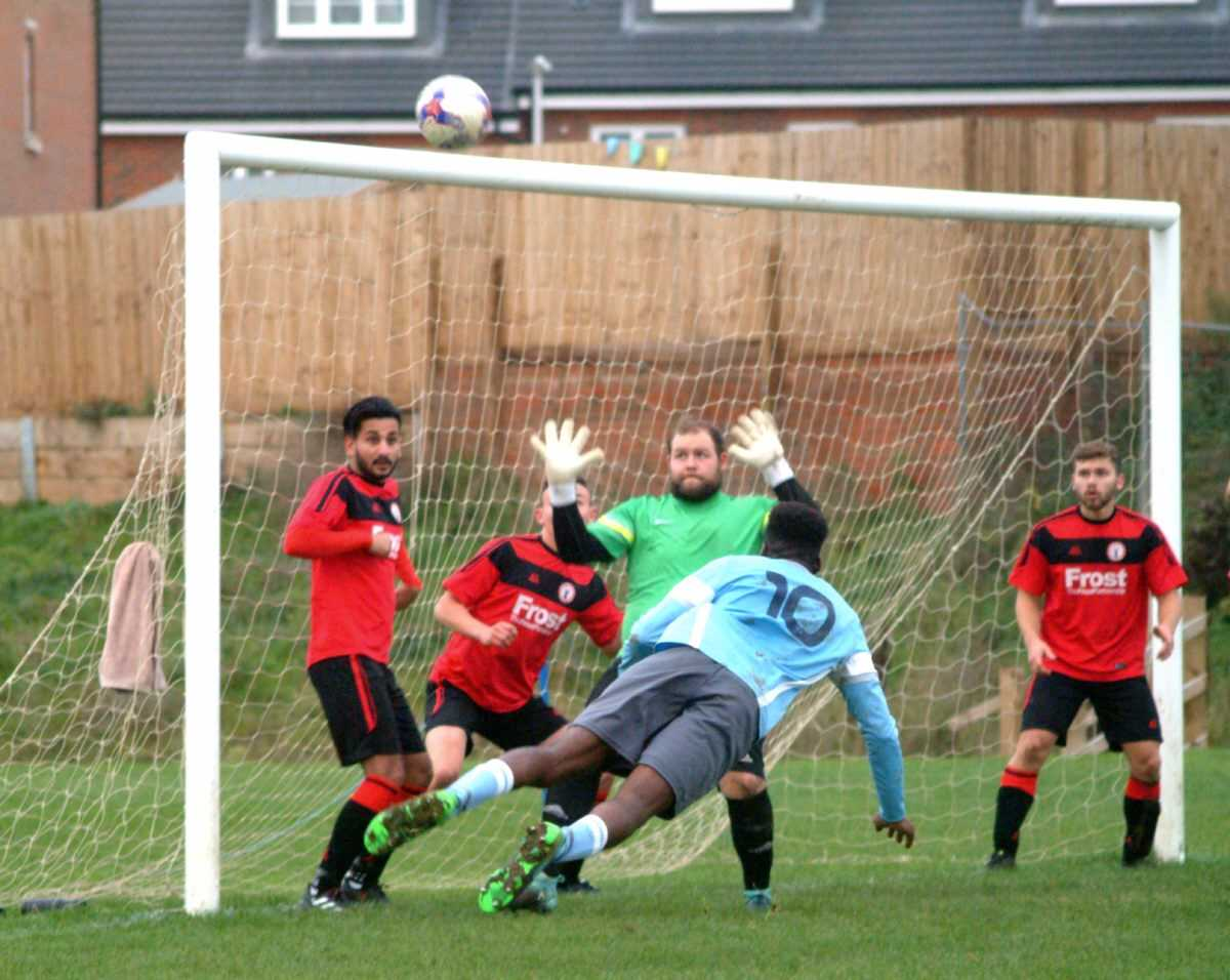 Woodley United Royals player Hayden Richardson heads over against Wraysbury Village