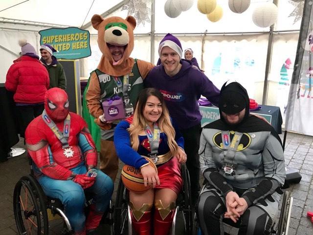 Wheelchair basketball team dons superhero costumes to meet super athlete
