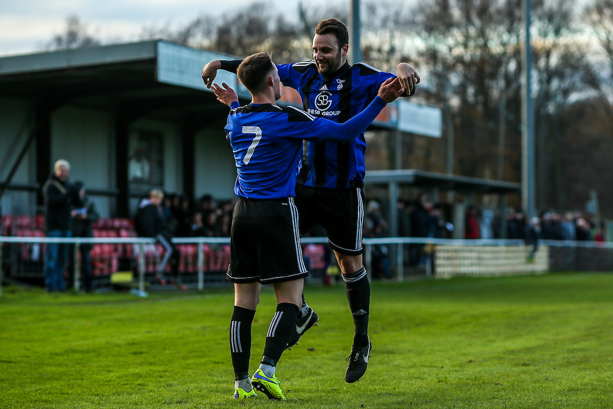 Joe Grant (7) celebrates scoring the winner with Adam Cornell    Picture by Neil Graham