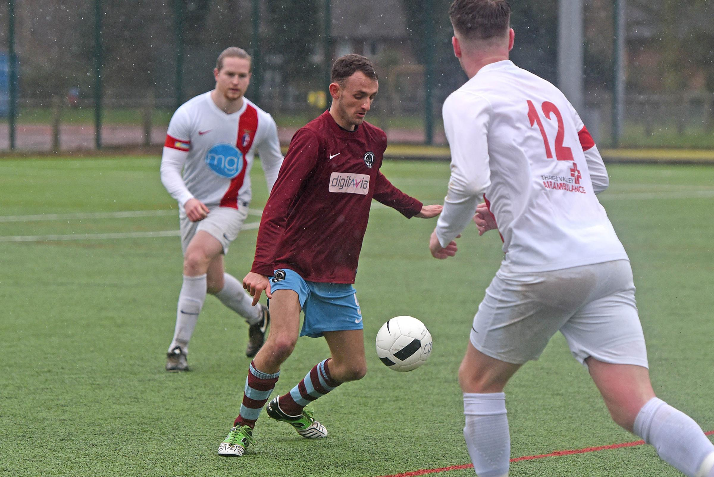 Berks County Reserves' player Richard Cumner (maroon) shields the ball against Harchester Hawks   Picture by Emma Sheppard   180234