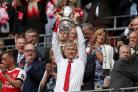 File photo dated 27-05-2017 of Arsenal manager Arsene Wenger lifts the FA Cup trophy