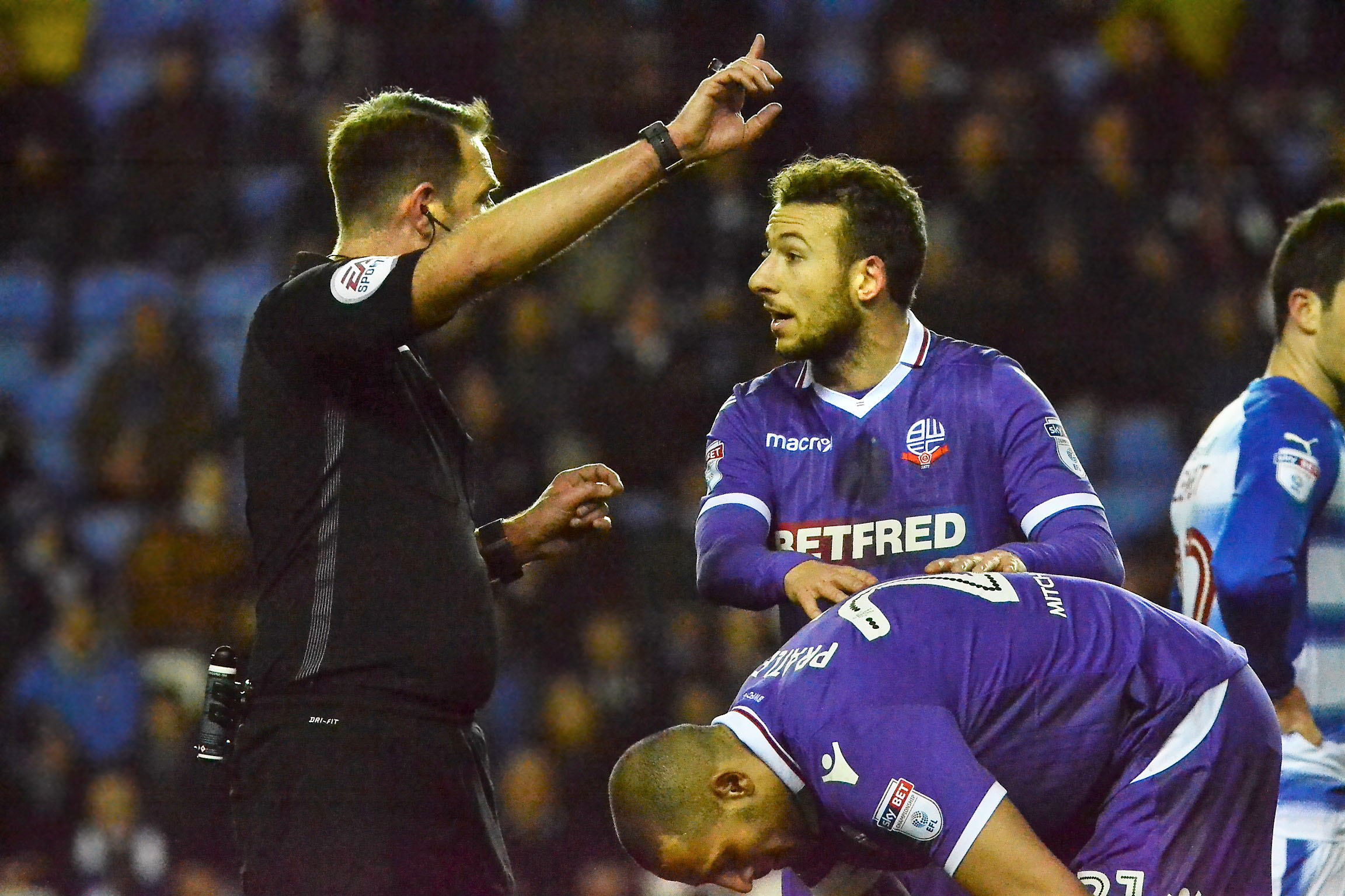 Bolton striker Adam Le Fondre gets a talking to from referee James Linington. Pictures: Chris Forsey. Code 180329.