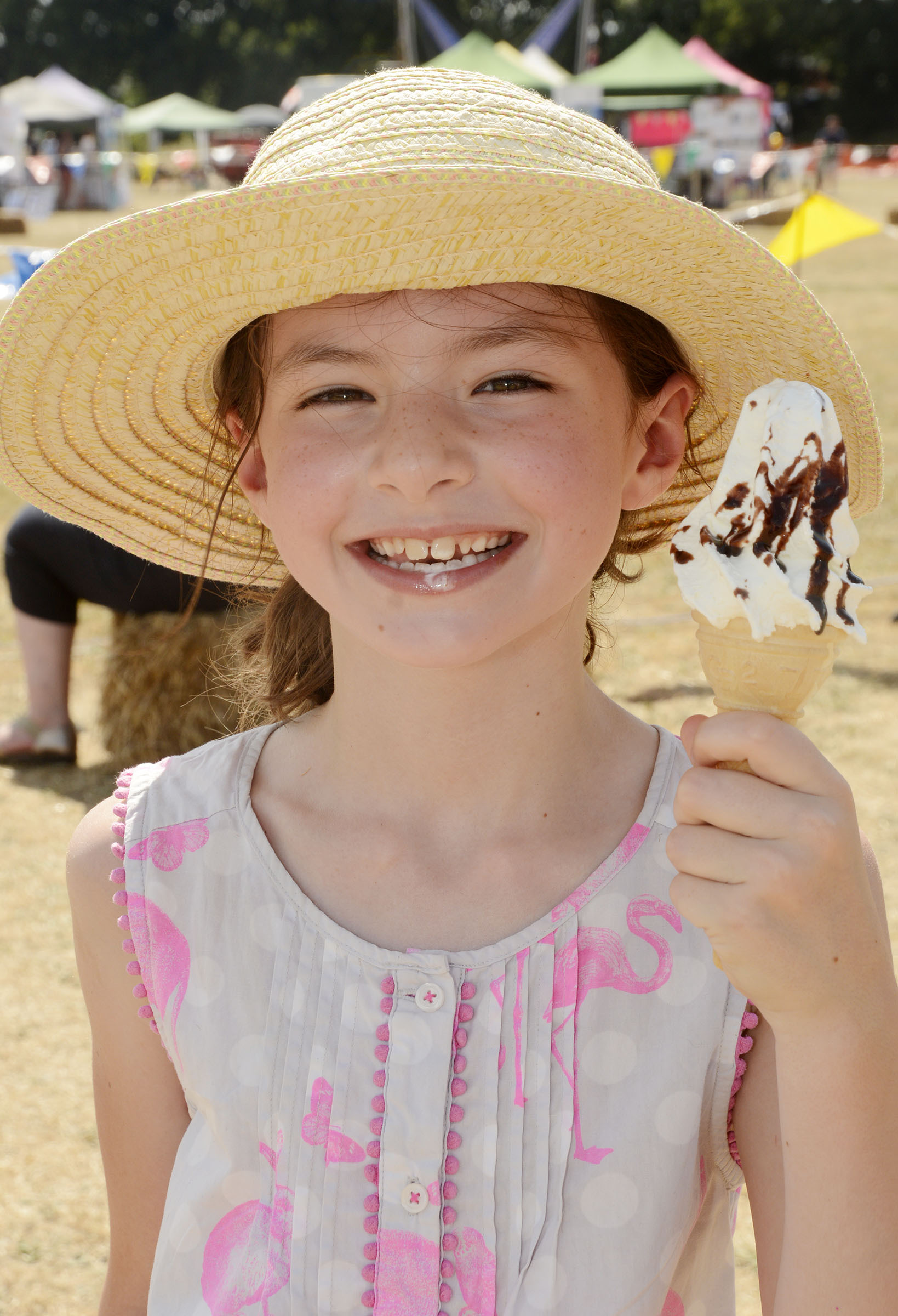 180706 - Mortimer Village Show - pics by Paul Johns.Emily Rooke, nine, enjoys an ice cream.