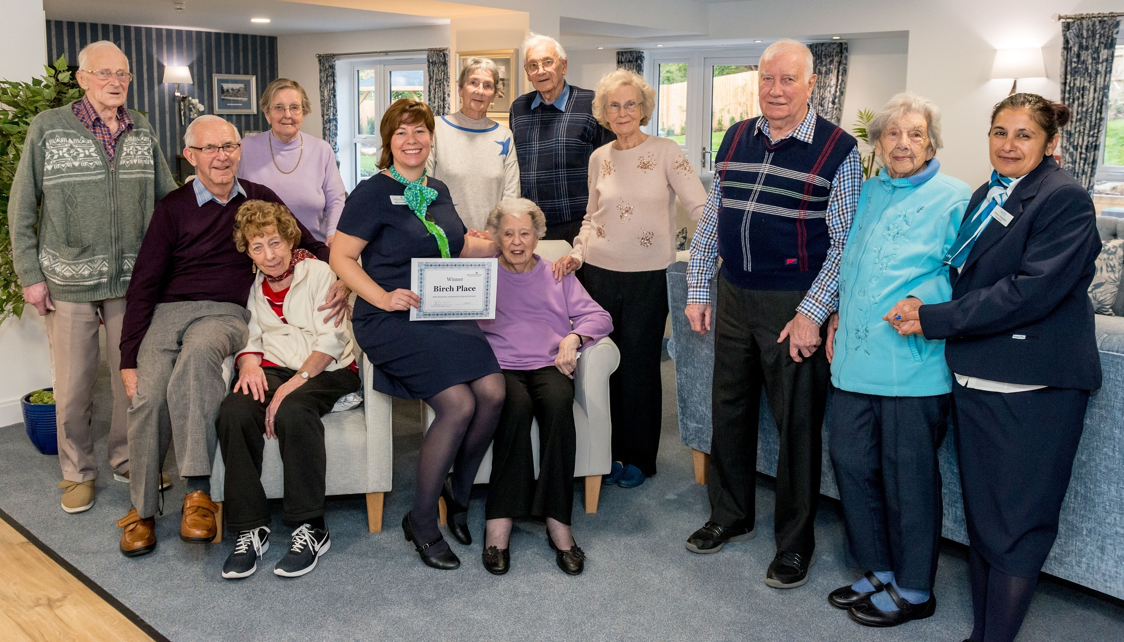 Residents from the Crowthorne Birch Place Retirement Living Plus development with the award