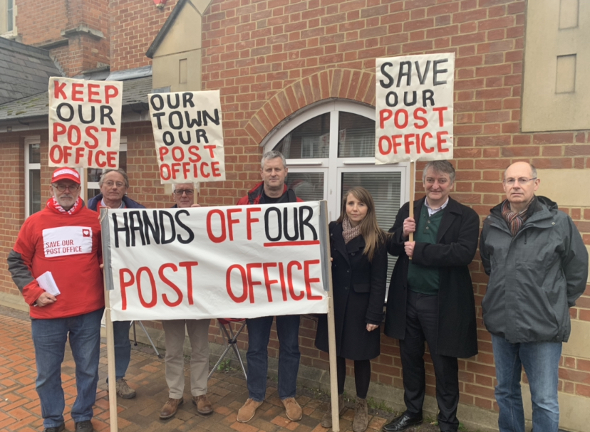 Labour campaigners outside the customer forum including councillors Andy Croy and Rachel Burgess (centre)