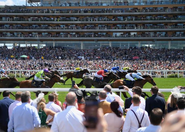 ASCOT, ENGLAND - JUNE 22:  Racegoers watch horses race from the Village on day 4 of Royal Ascot at Ascot Racecourse on June 22, 2018 in Ascot, England.  (Photo by Stuart C. Wilson/Getty Images for Ascot Racecourse ).