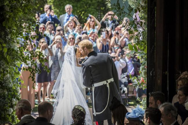 Meghan and Harry kiss on their wedding day