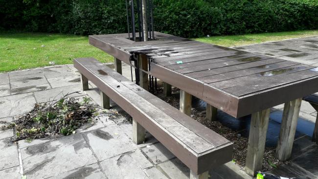Vandalism incident results in visible hole in park bench